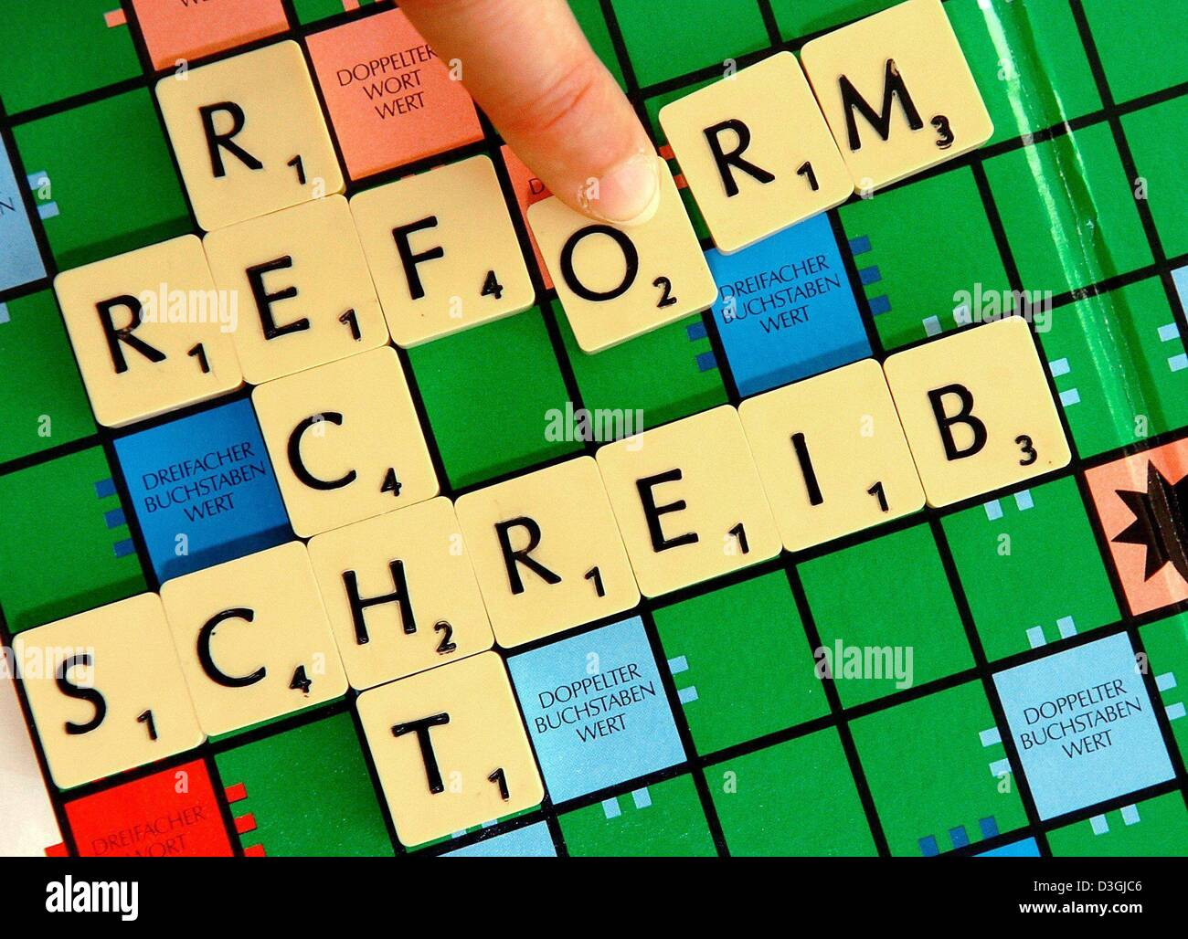 dpa a finger moves the letter o into place to form the word rechtschreibreform spelling reform on a scrabble board in schwerin germany