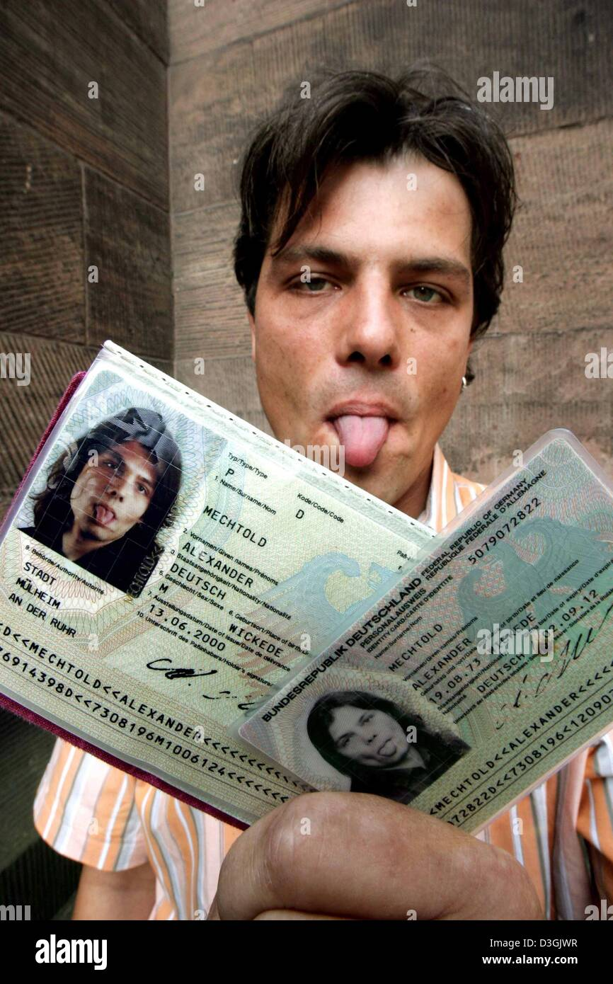 (dpa) - German cinematographer Alexander Mechtold shows his id cards while he sticks out his tongue in Duesseldorf, - Stock Image