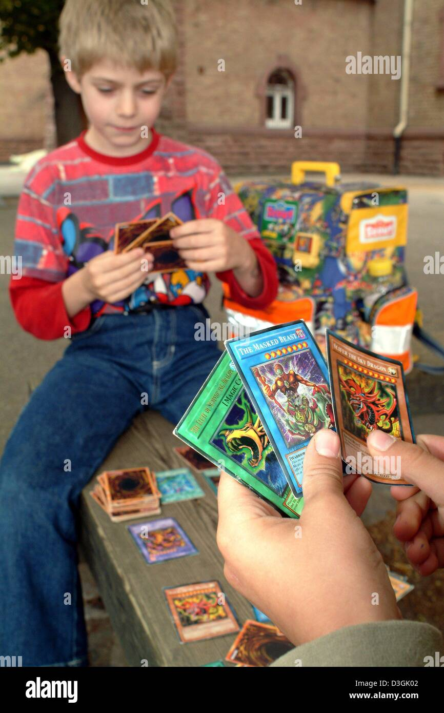 dpa two boys play with yugioh cards in their schoolyard in stock
