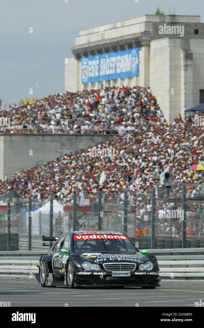 (dpa) - British DTM pilot Gary Paffett steers his AMG-Mercedes C class along the Norisring racetrack during the Stock Photo