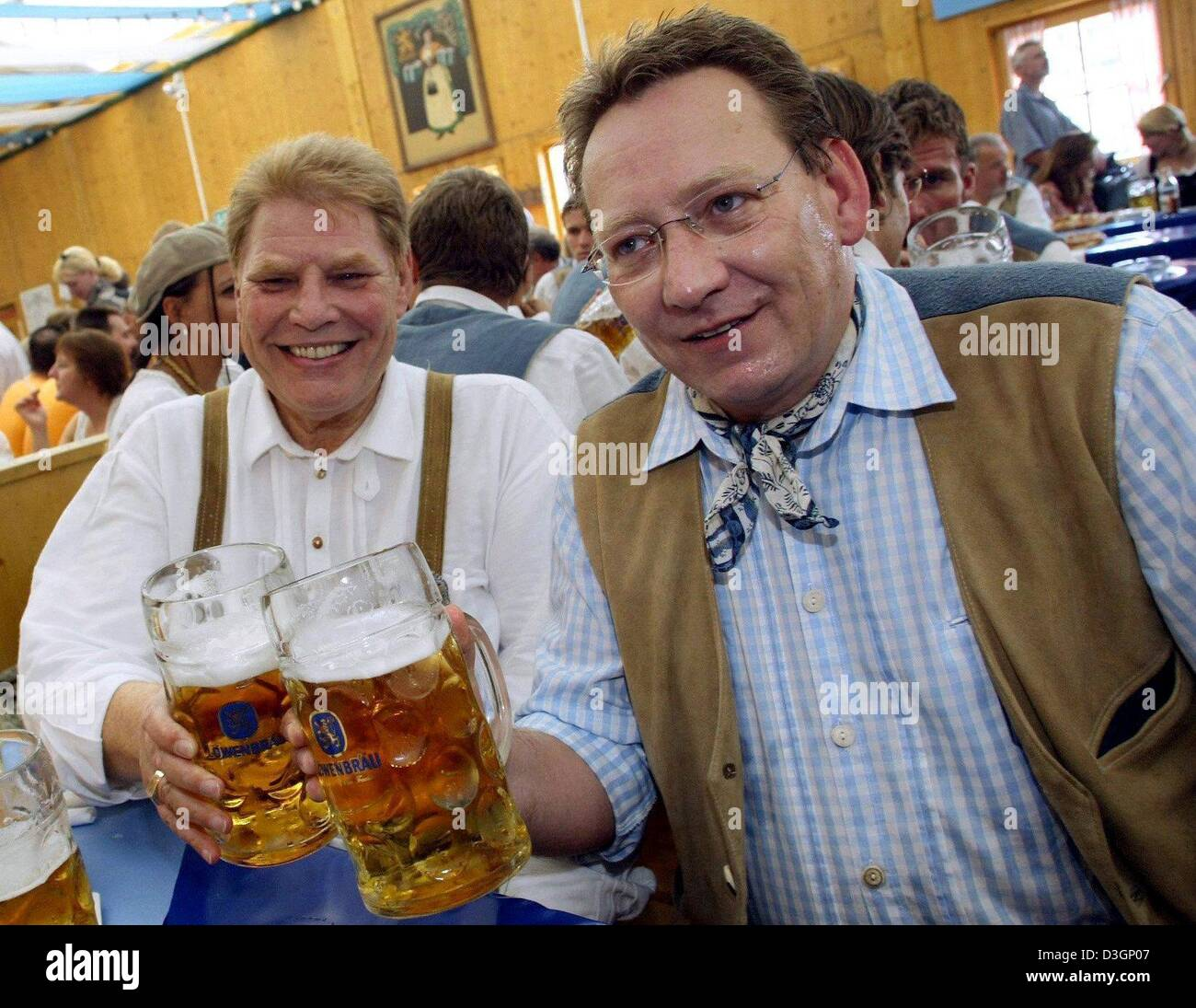 (dpa files) The president of the German premier league soccer club TSV 1860 MunichKarl-Heinz Wildmoser (left ) and his son and business manager Karl-Heinz Wildmoser junior celebrate on the Oktoberfest in Munich on 21 September 2003. Wildmoser was arrested on Tuesday, 9 March 2004, along with his son as well as two unnamed persons. An official said that they were investigating fraud Stock Photo