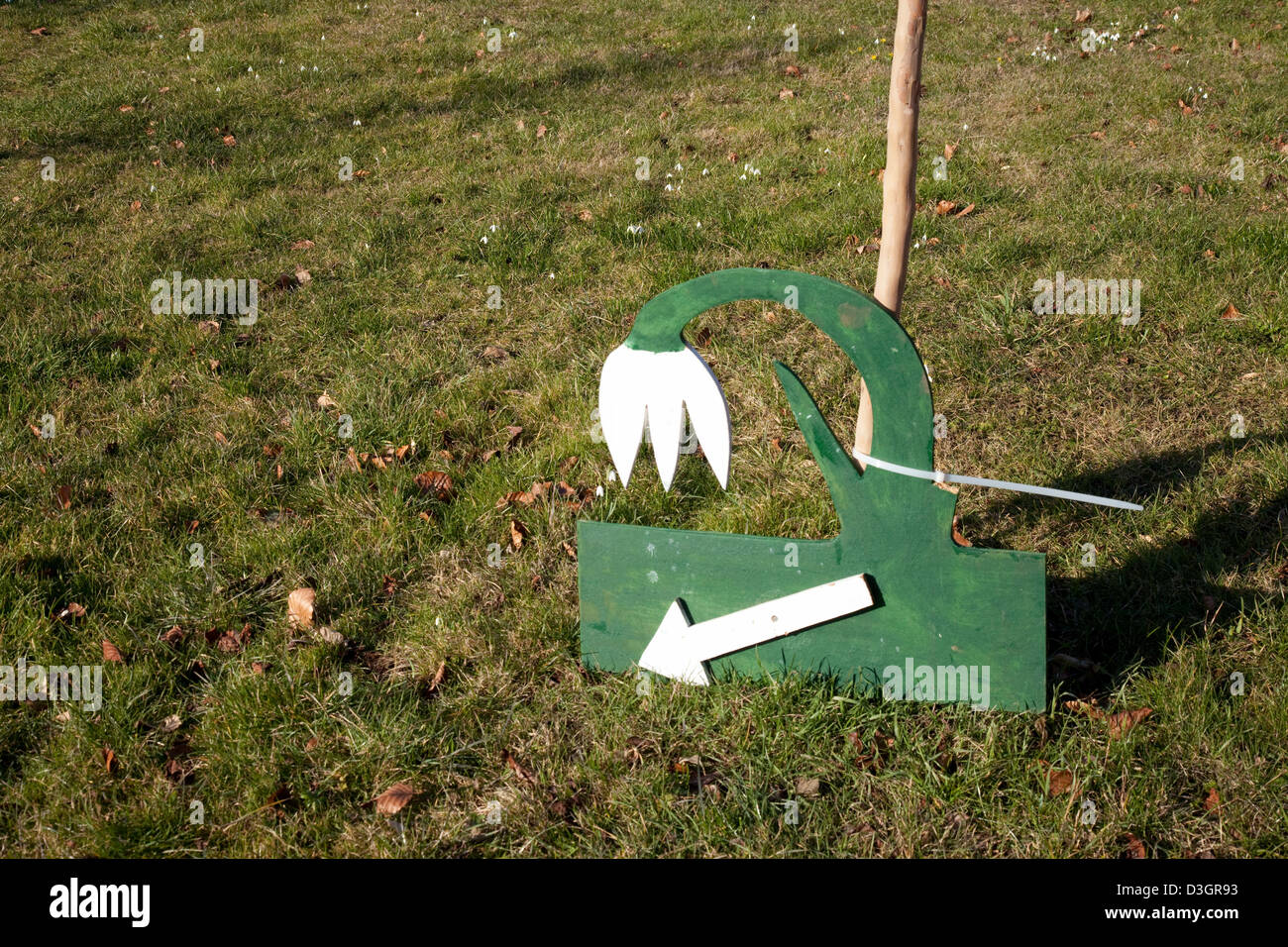 A sign pointing to snowdrops, Chippenham Park house Cambridgeshire UK - Stock Image