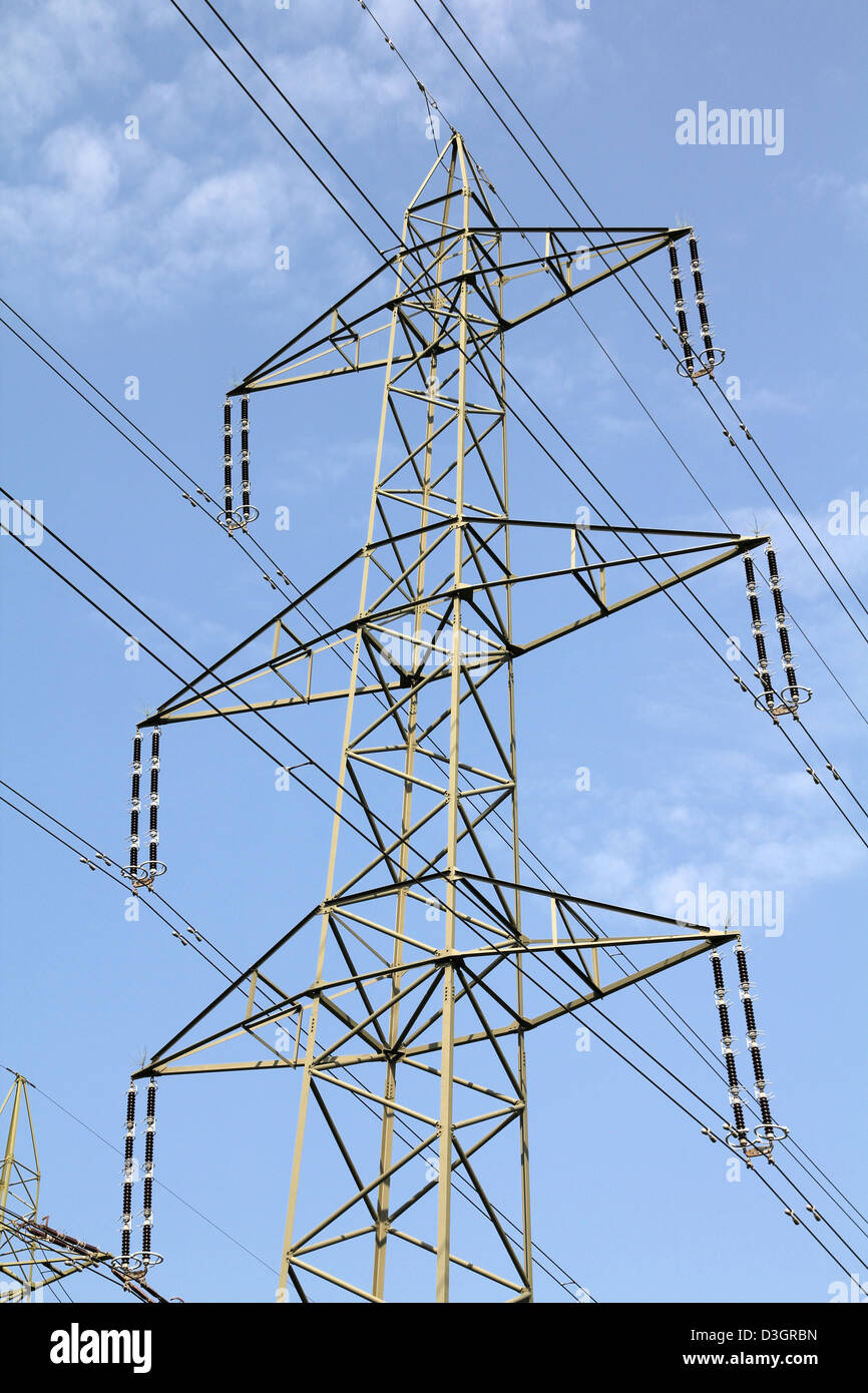 High voltage electricity pylon in Switzerland. Power grid. - Stock Image