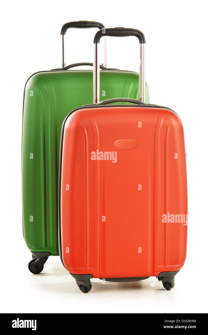 Luggage consisting of polycarbonate suitcases isolated on white background - Stock Image