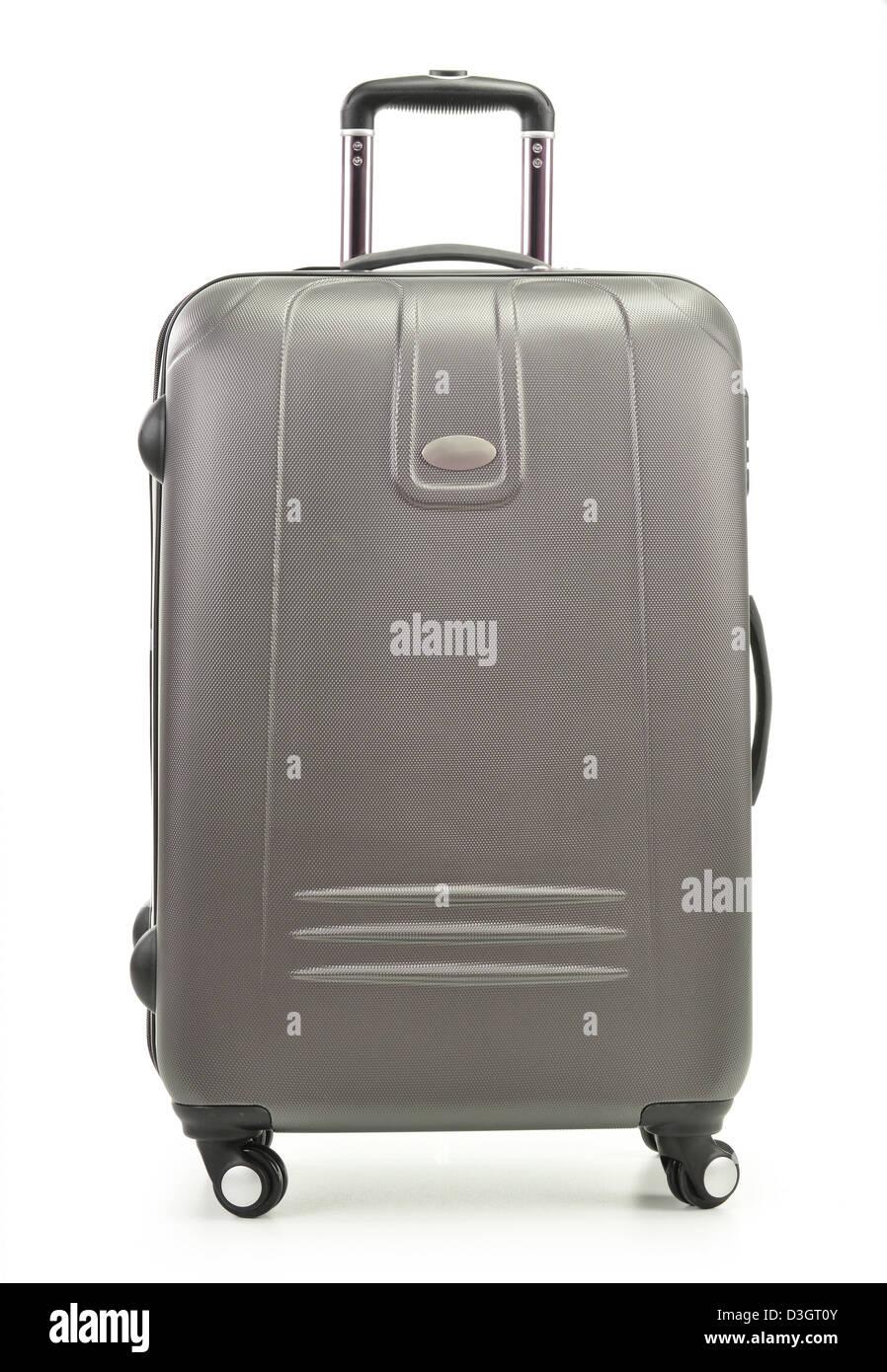 Large polycarbonate suitcase isolated on white - Stock Image