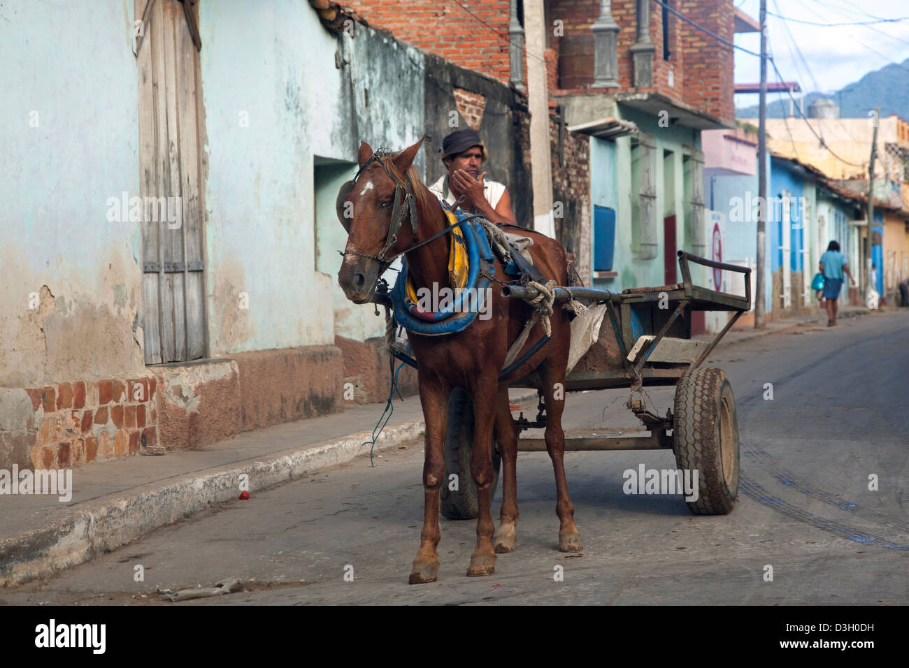 Horse pulling cart in the streets of Trinidad, Cuba, Caribbean - Stock Image