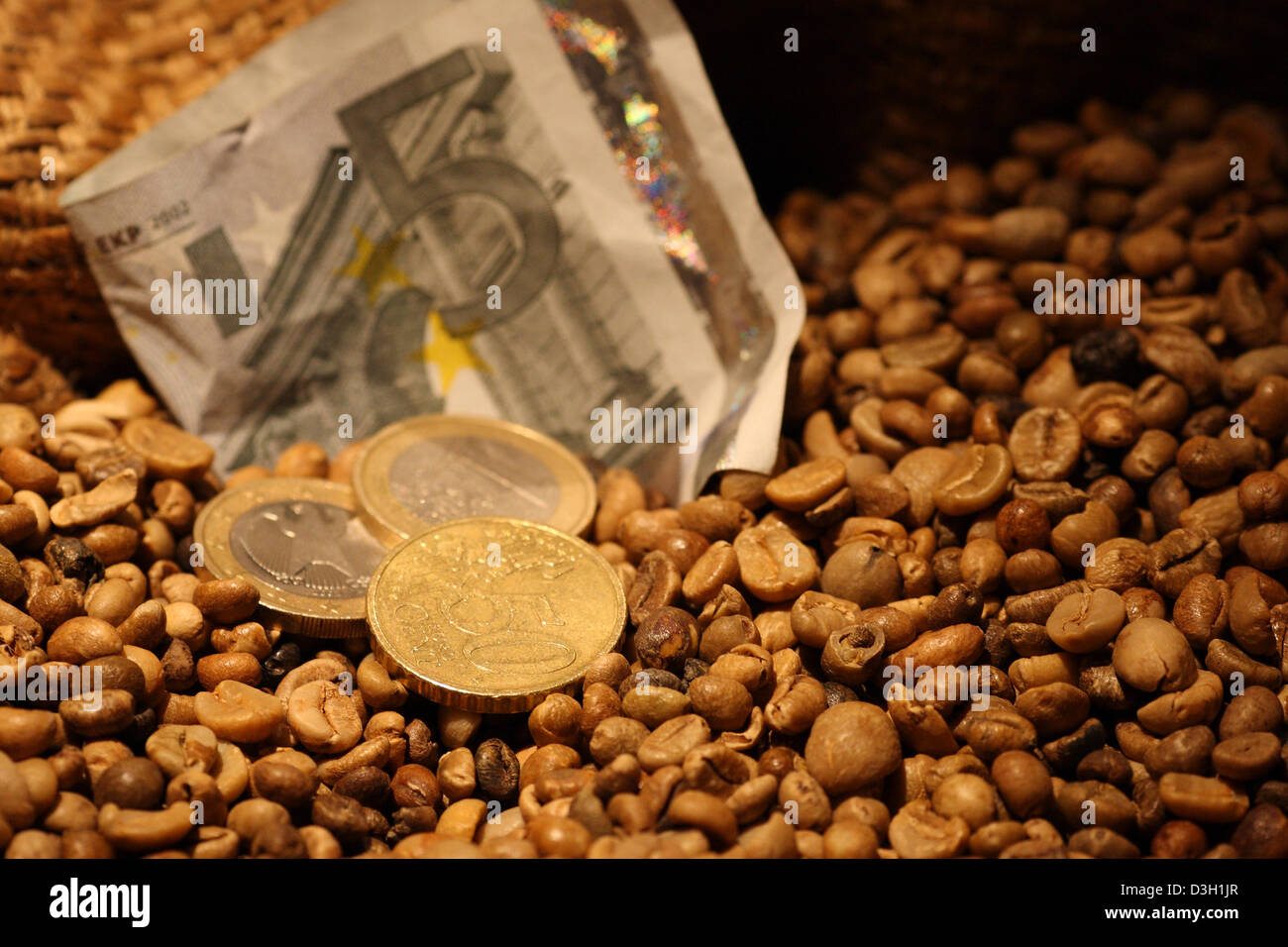 Hamburg, Germany, coffee beans in a burlap sack with a 5-euro note and coins - Stock Image