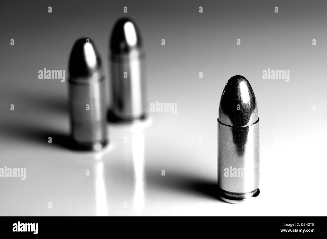 9mm Winchester Luger bullets against white backdrop. - Stock Image