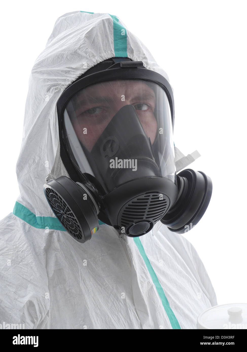 Closeup of spray painter wearing white coverall and respirator shot over white background - Stock Image