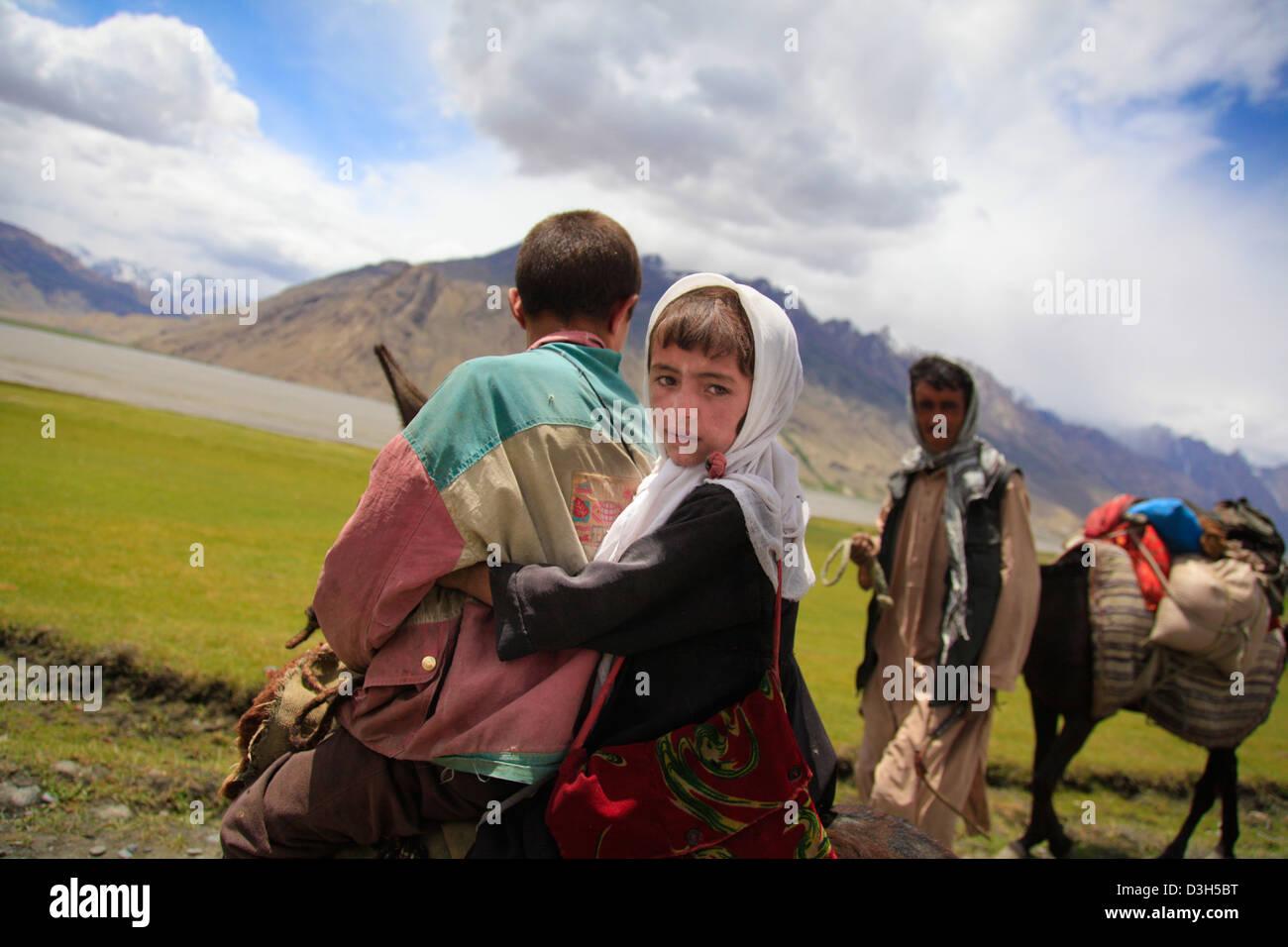 Schoolchildren on their way to school near Sarhad-e-broghil in the Wakhan Corridor, Badakhshan, Afghanistan Stock Photo