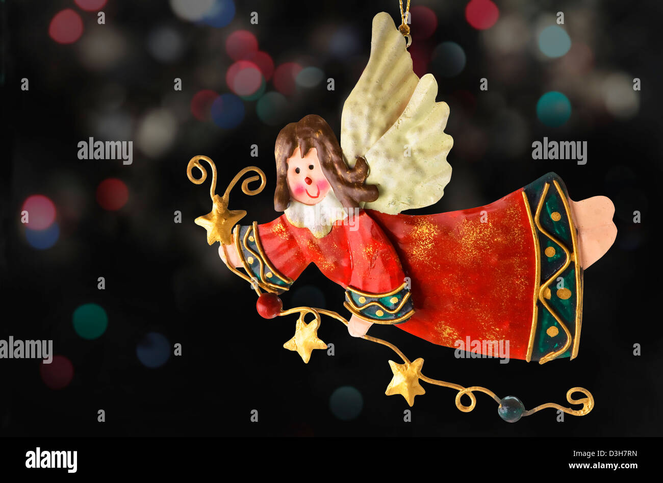 Tinplate Angel, Christmas tree ornaments, with a background of blurry lights - Stock Image