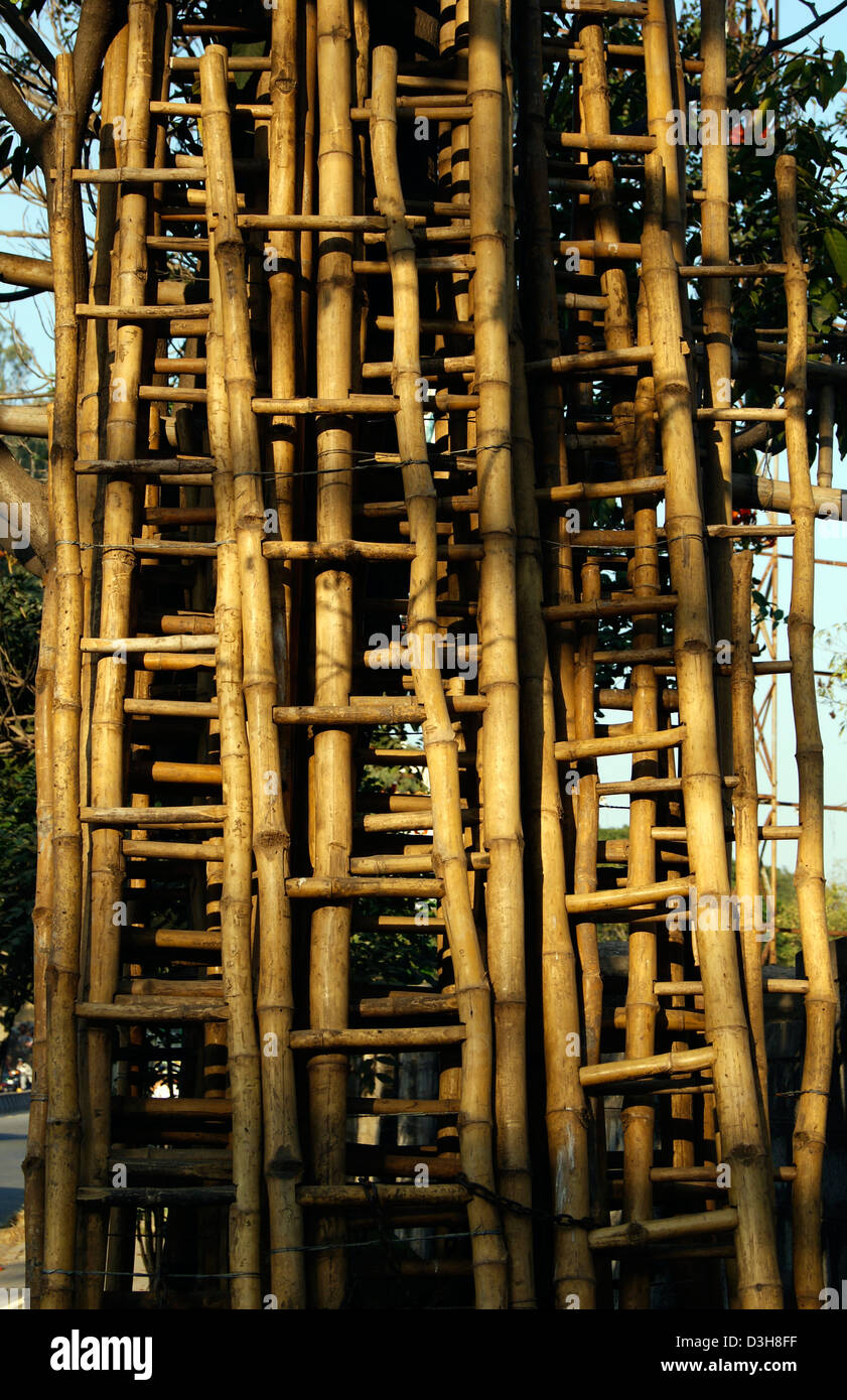 Ladder made up of Bamboo Tree on sales.Lot of Bamboo Ladders VIew on Roadside at Bangalore city India - Stock Image