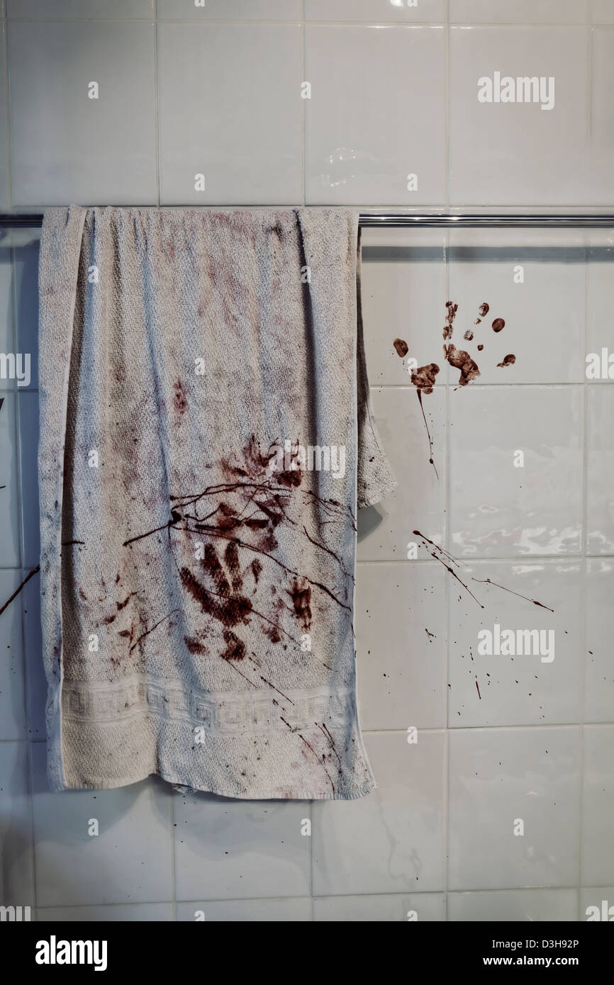a bloody towel on a towel rail - Stock Image