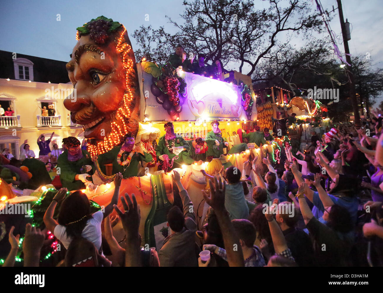Feb. 10, 2013 - New Orleans, LOUISIANA, UNITED STATES - The crowds cheer for beads as a float in the Krewe of Bacchus Stock Photo