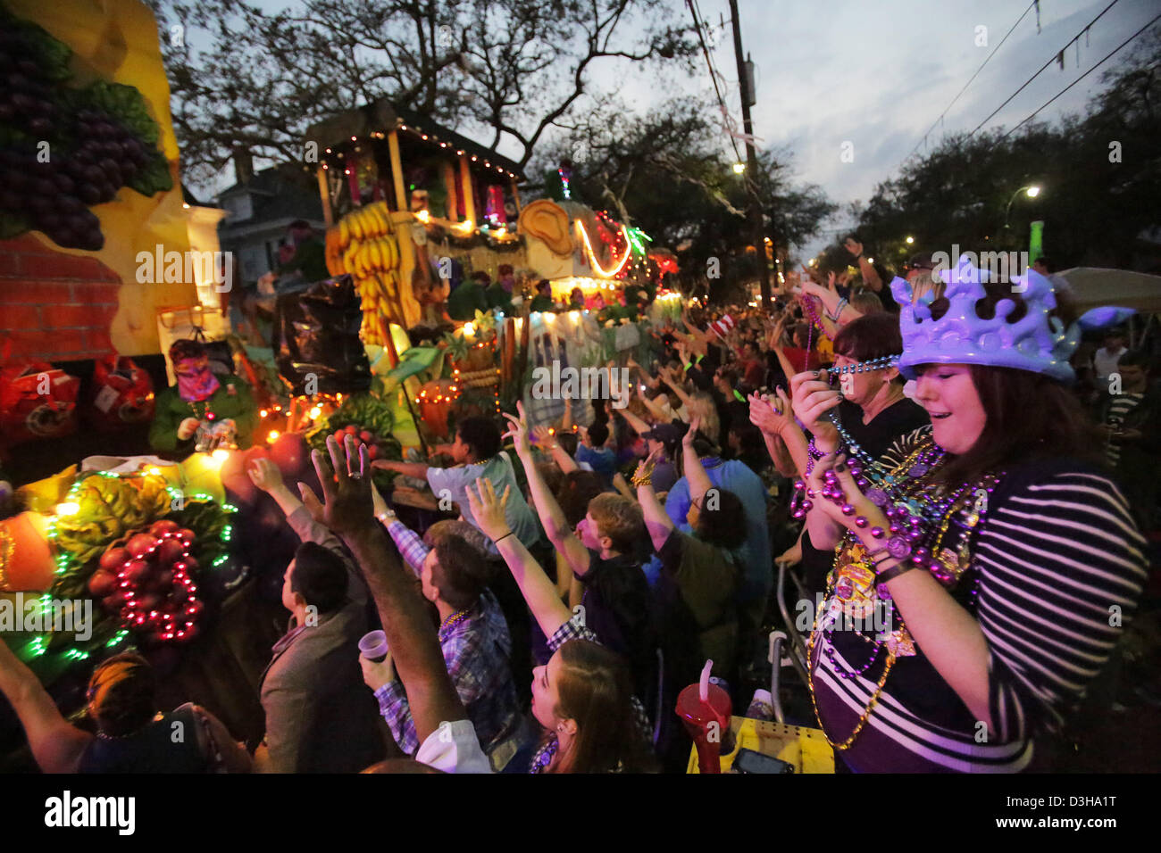 Feb. 10, 2013 - New Orleans, LOUISIANA, UNITED STATES - Bekka Waldera (right) holds beads caught from a float in Stock Photo