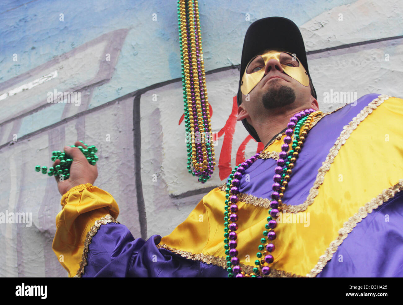 Feb. 10, 2013 - New Orleans, LOUISIANA, UNITED STATES - A masked float rider throws out beads during the Krewe of Stock Photo