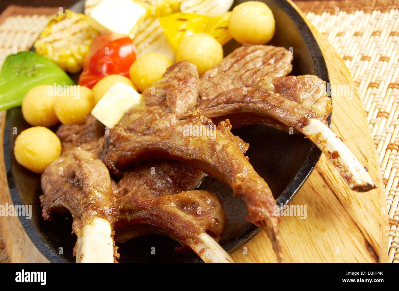 Japanese cuisine .Japanese spare ribs on a plate .meat lamb on rib  - Stock Image