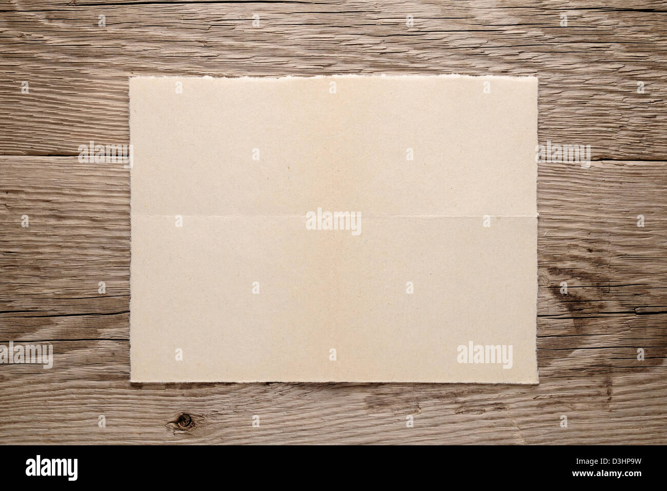 Old paper on wooden background - Stock Image