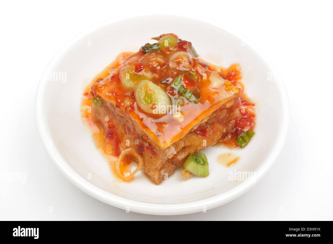 Tofu and sauce - Stock Image