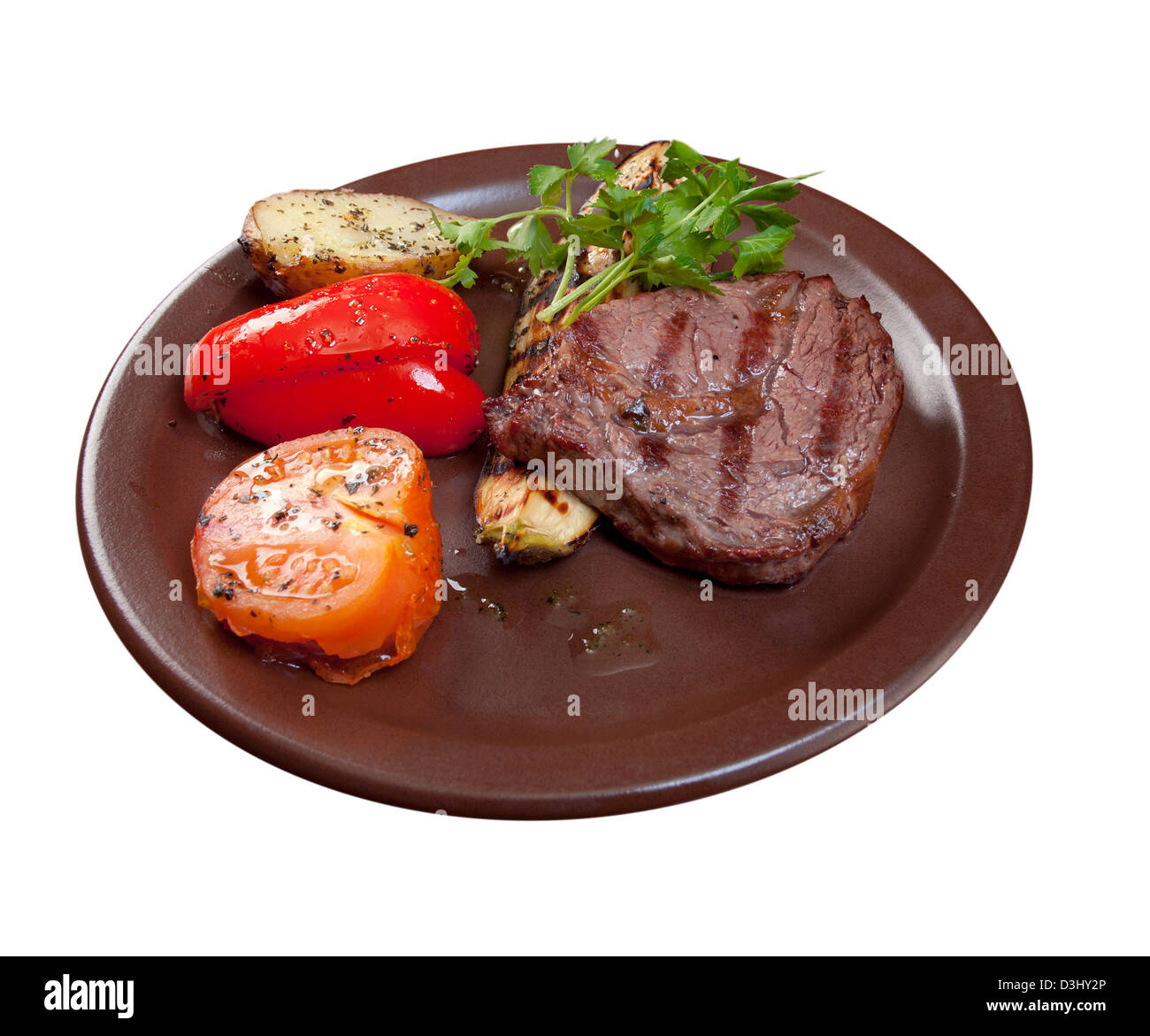 Grilled beef on white plate with vegetable.isolated on white background. - Stock Image