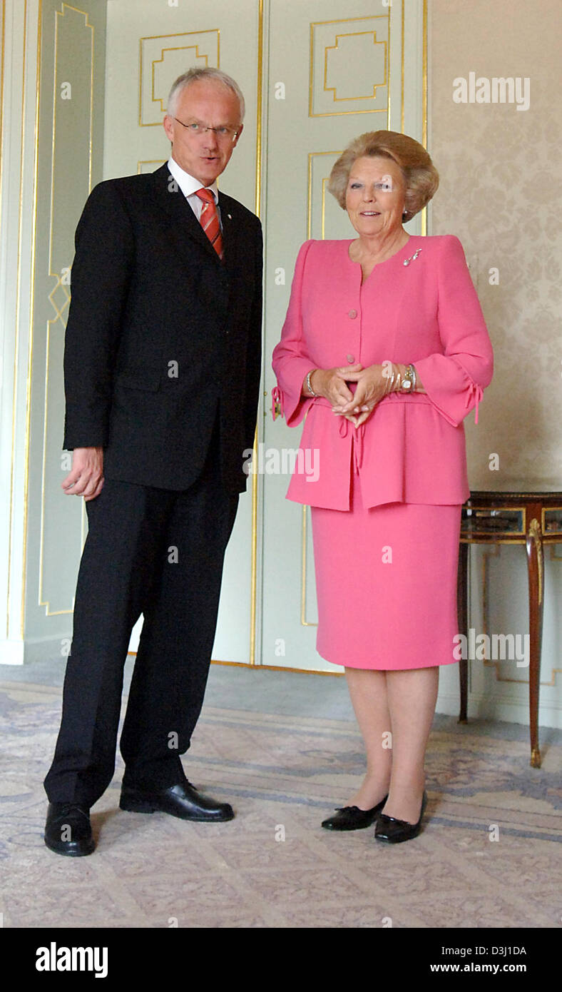 (dpa) - North Rhine Westphalia's new Minister President Juergen Ruettgers smiles together with Queen Beatrix of Stock Photo
