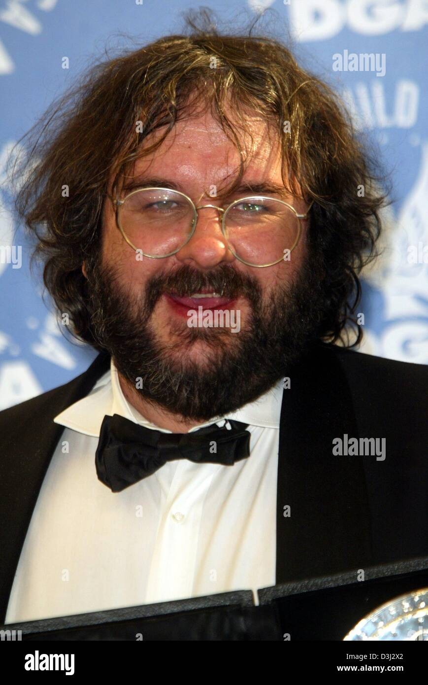 f9bbbcf829fe (dpa) - Film director Peter Jackson from New Zealand, smiles as he poses  with his trophy which he was awarded at the 56th Directors Guild Awards  ceremony in ...