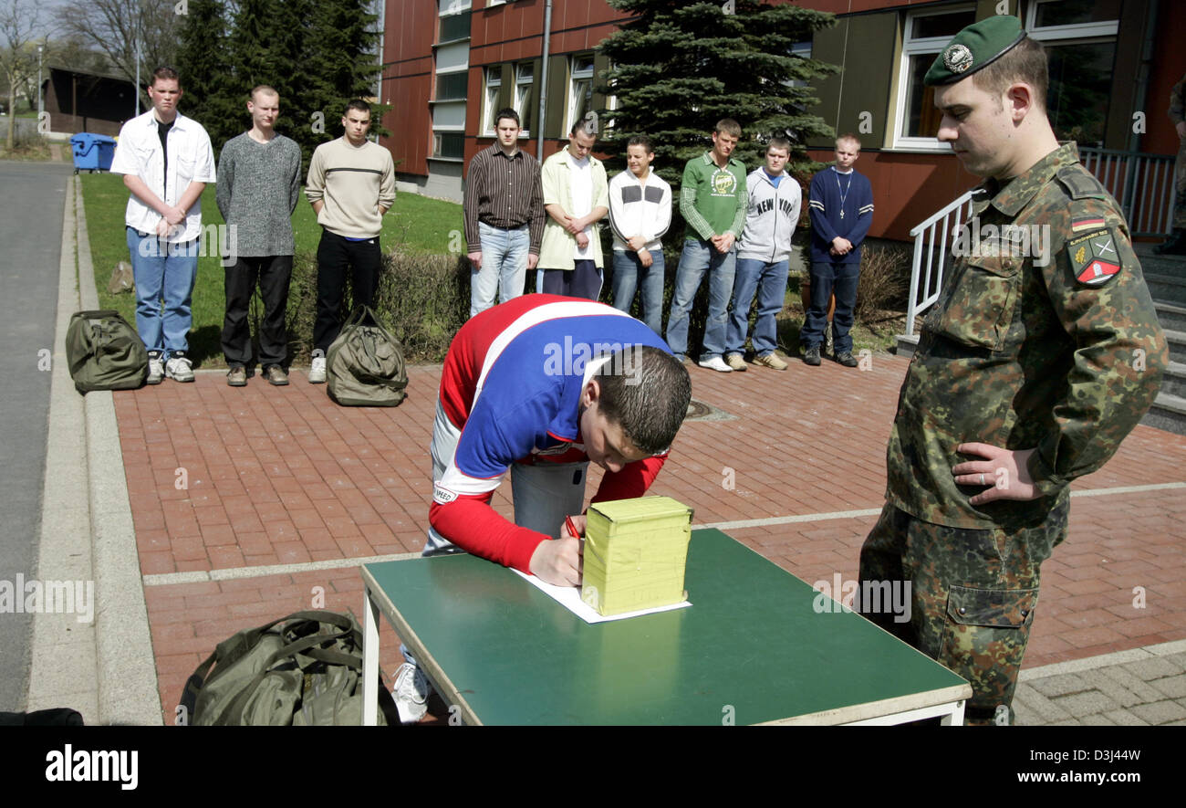 (dpa) - Conscipts in civilian clothes sign in to a list on a table before dressing at the Knuell barracks in Schwarzenborn, Stock Photo