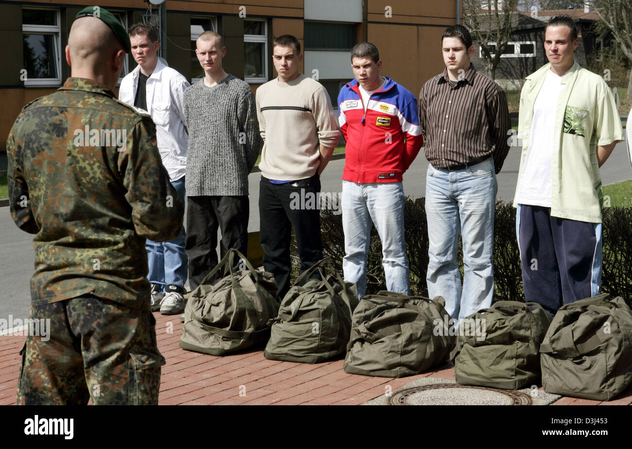 (dpa) - Conscripts in civilian clothes report with their luggage before dressing and are briefed by an instructor Stock Photo