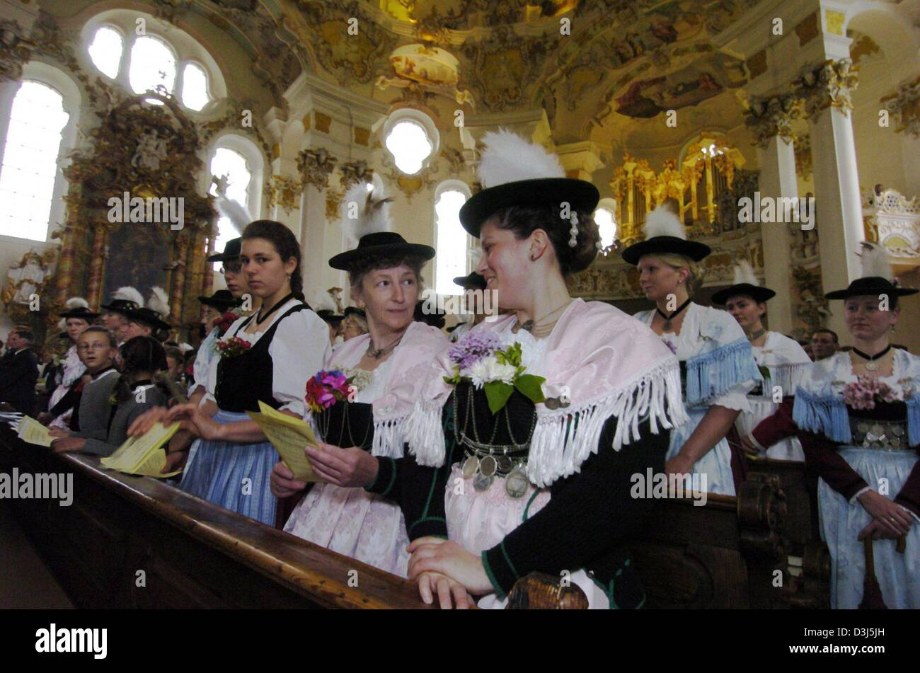 (dpa) - A group of women dressed in traditional costumes attend a church service on Whit Monday in Steingaden, Germany, - Stock Image