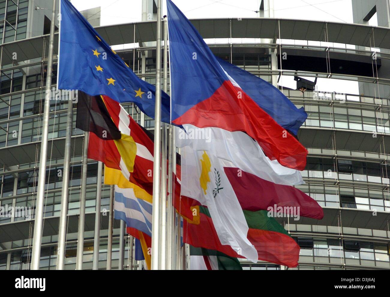 (dpa) - The flags of the new members of the European Union (R, Czech Republic in front) flutter next to the flags of the old EU members (L, European flag in front) in front of the European Parliament in Strasbourg, France, 3 May 2004. Stock Photo