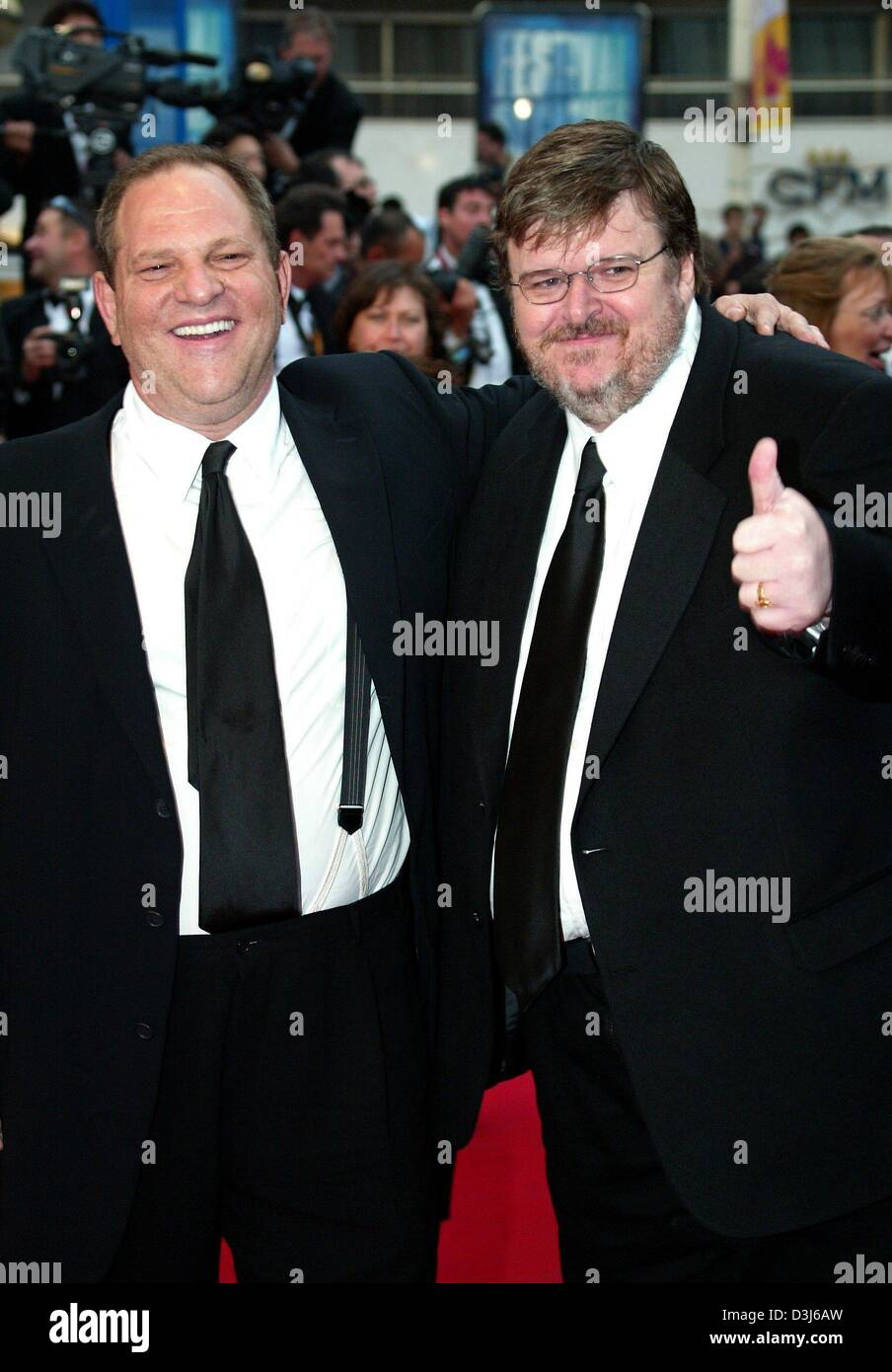 (dpa) - Film producer Harvey Weinstein (L) and US director Michael Moore smile during a photocall after the awardsStock Photo