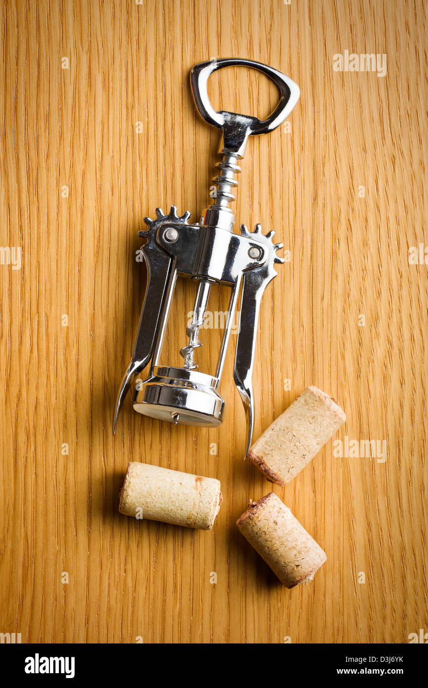 wine cork and corkscrew on wooden table Stock Photo