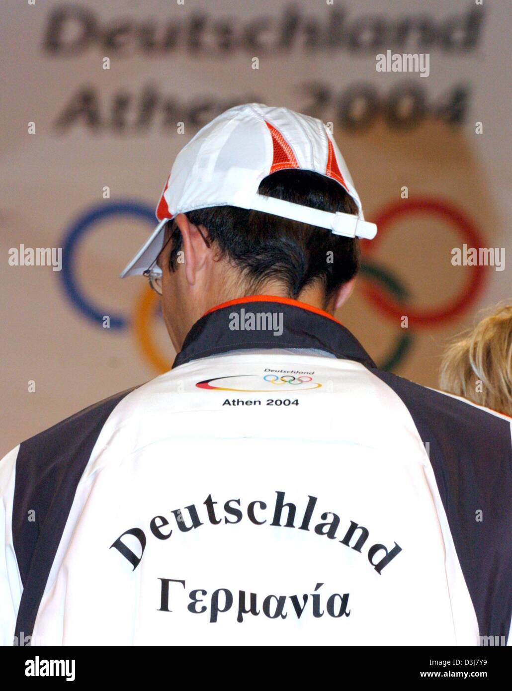 (dpa) - German athelet Ingo Schultz presents the writing on the back of his jacket which reads 'Germania' - Stock Image