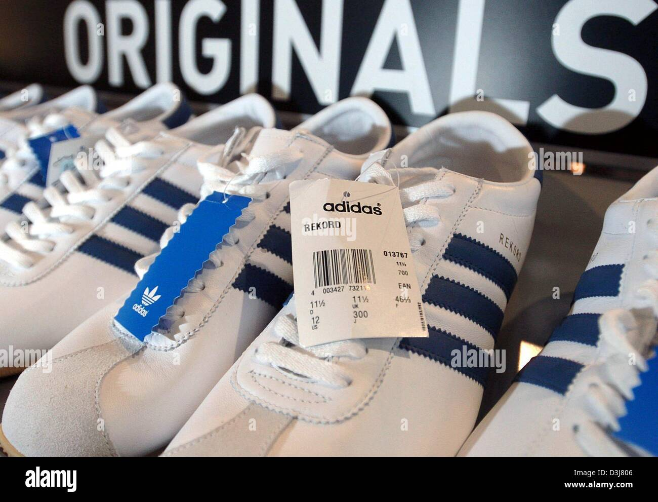 6817bd9a3d2 (dpa files) -  Original  sneakers by adidas are for sale in a shelf at the adidas  Outlet Store in Herzogenaurach