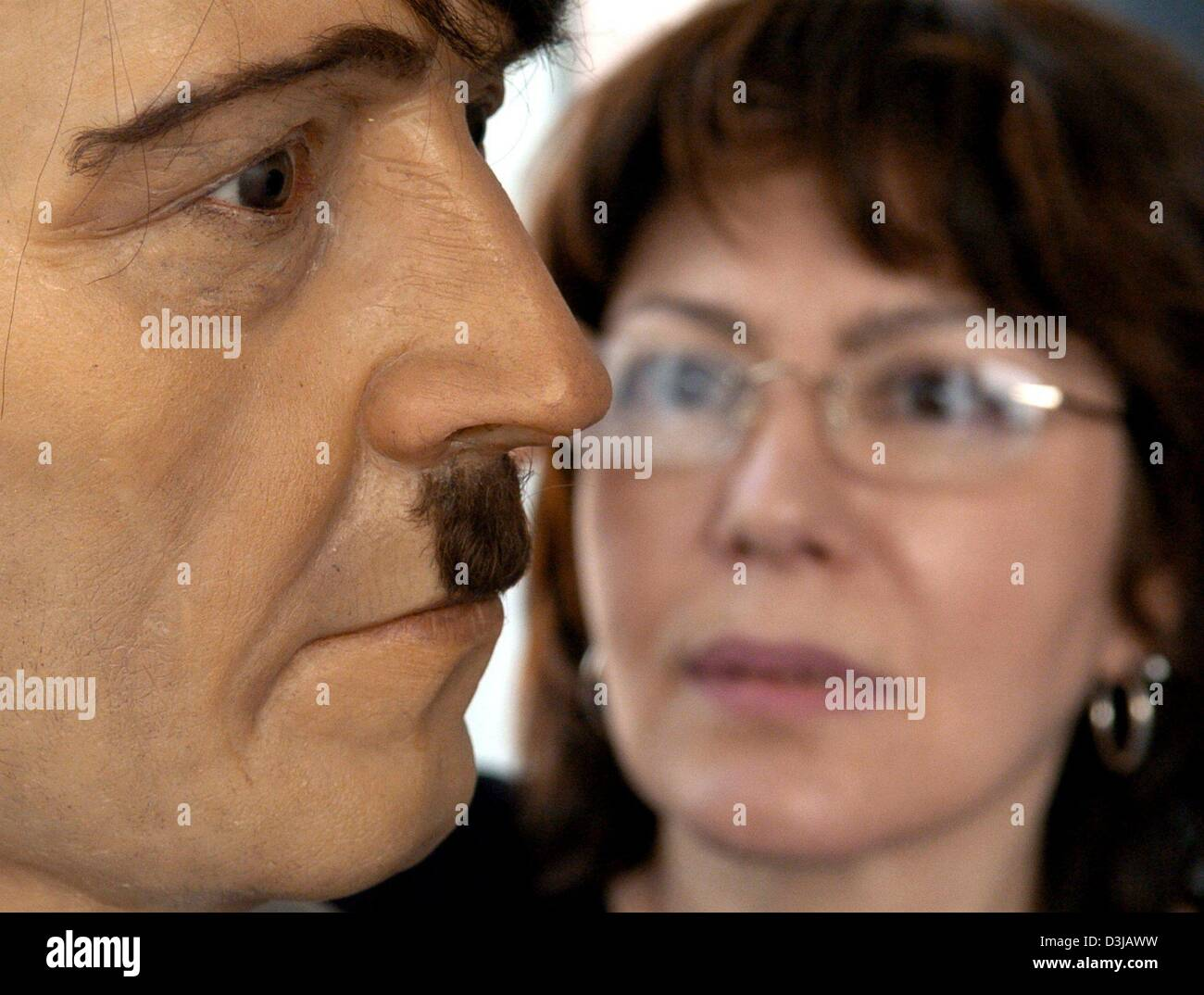 (dpa) A wax figure of Adolf Hitler is observed by a visitor at the wax works in the Friedrichstrasse in Berlin on - Stock Image