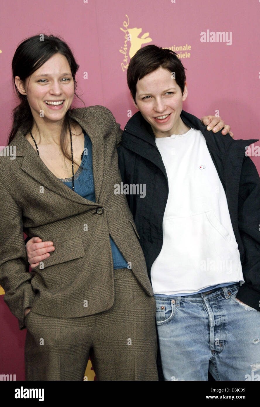 (dpa) - Actors Sabine Timoteo (L) and Julia Hummer embrace as they arrive at the press conference for their movie Stock Photo