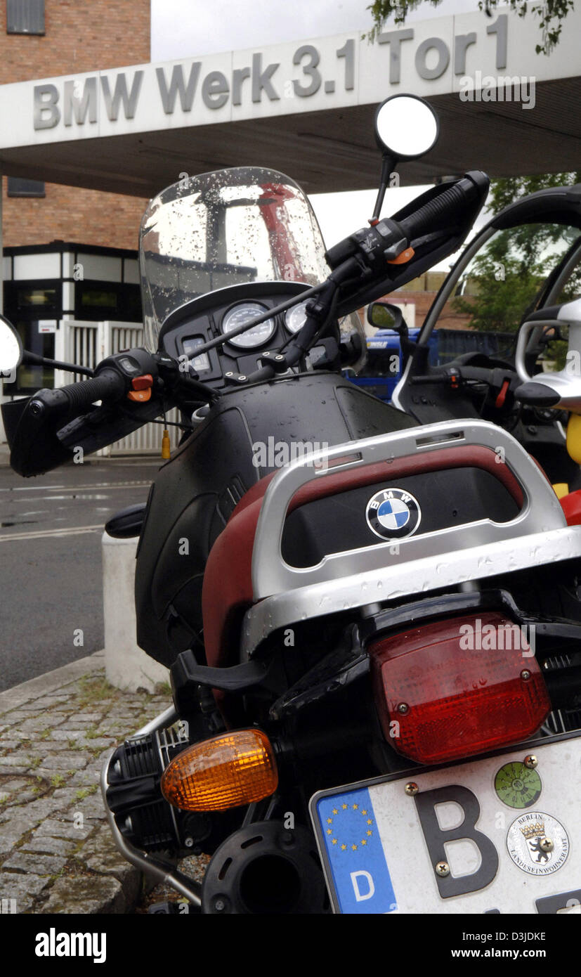 dpa) - A BMW motorcycle stands parked in front of the