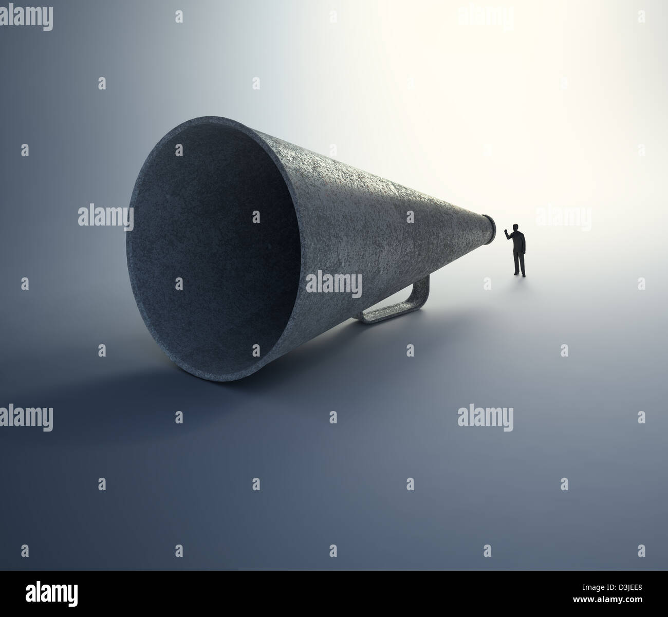 A tiny man speaking through a vintage megaphone - Stock Image