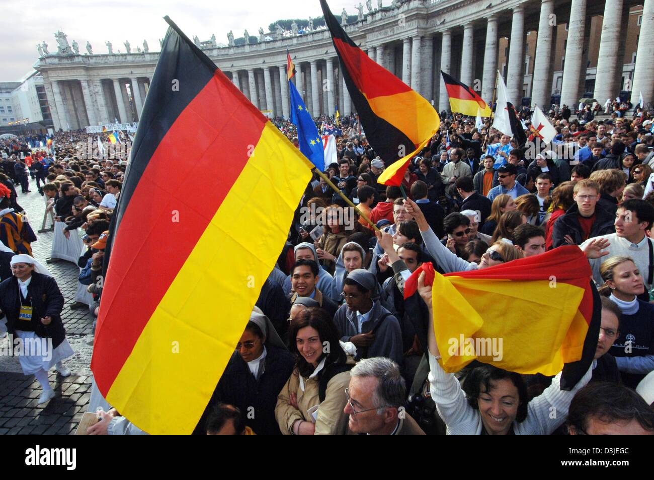 dpa) - German pilgrims sway their flags during the church