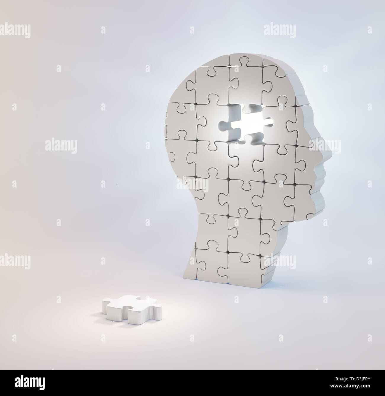 A head build out of puzzle pieces missing a single piece - psychology and mental health concept - Stock Image