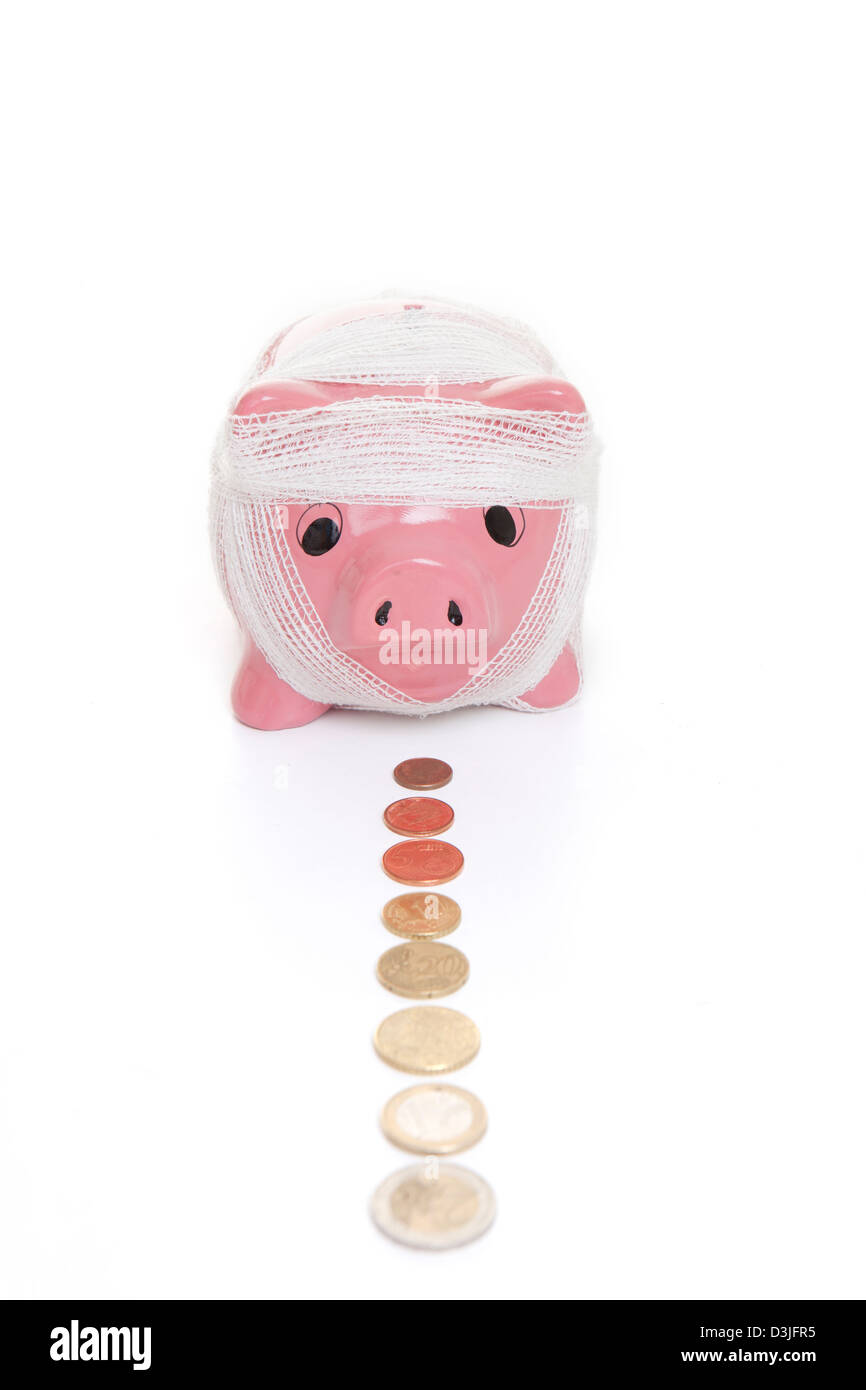 saving in piggy bank for health care concept - Stock Image