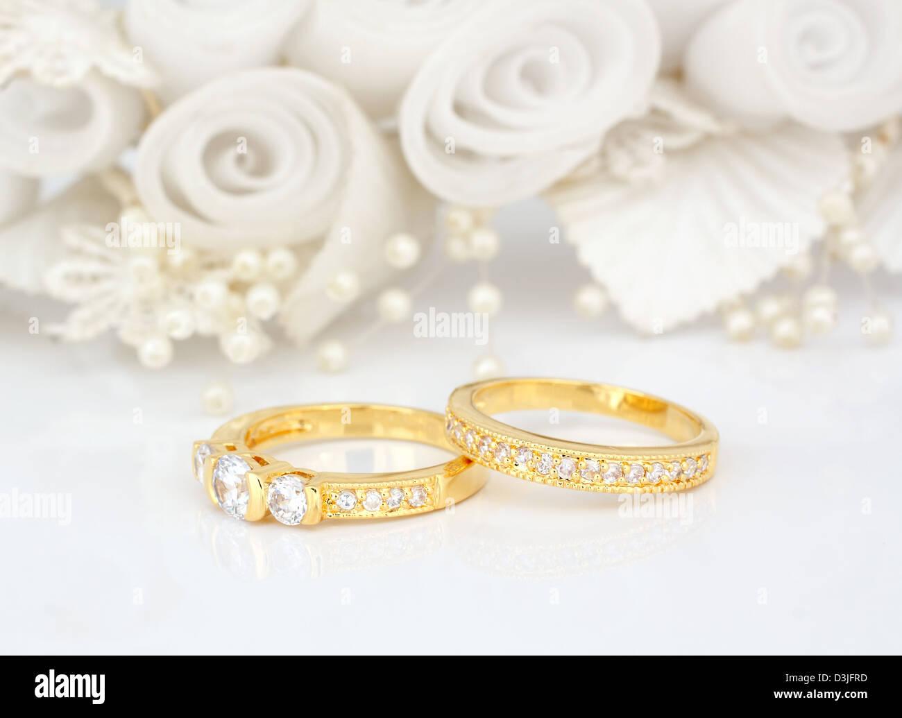 Gold Wedding Rings On Flowers Background Stock Photo 53882625 Alamy