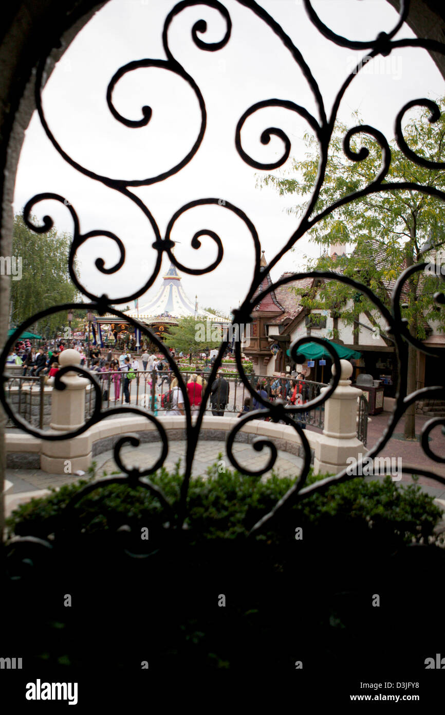 View of the main street in Disney land Paris through a window - Stock Image