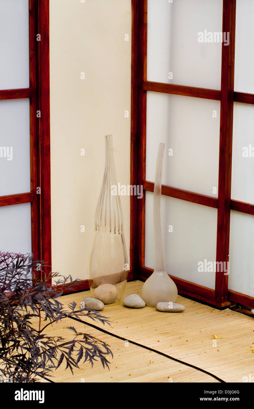 Still life with arrangements on the oriental touched patio. Stock Photo