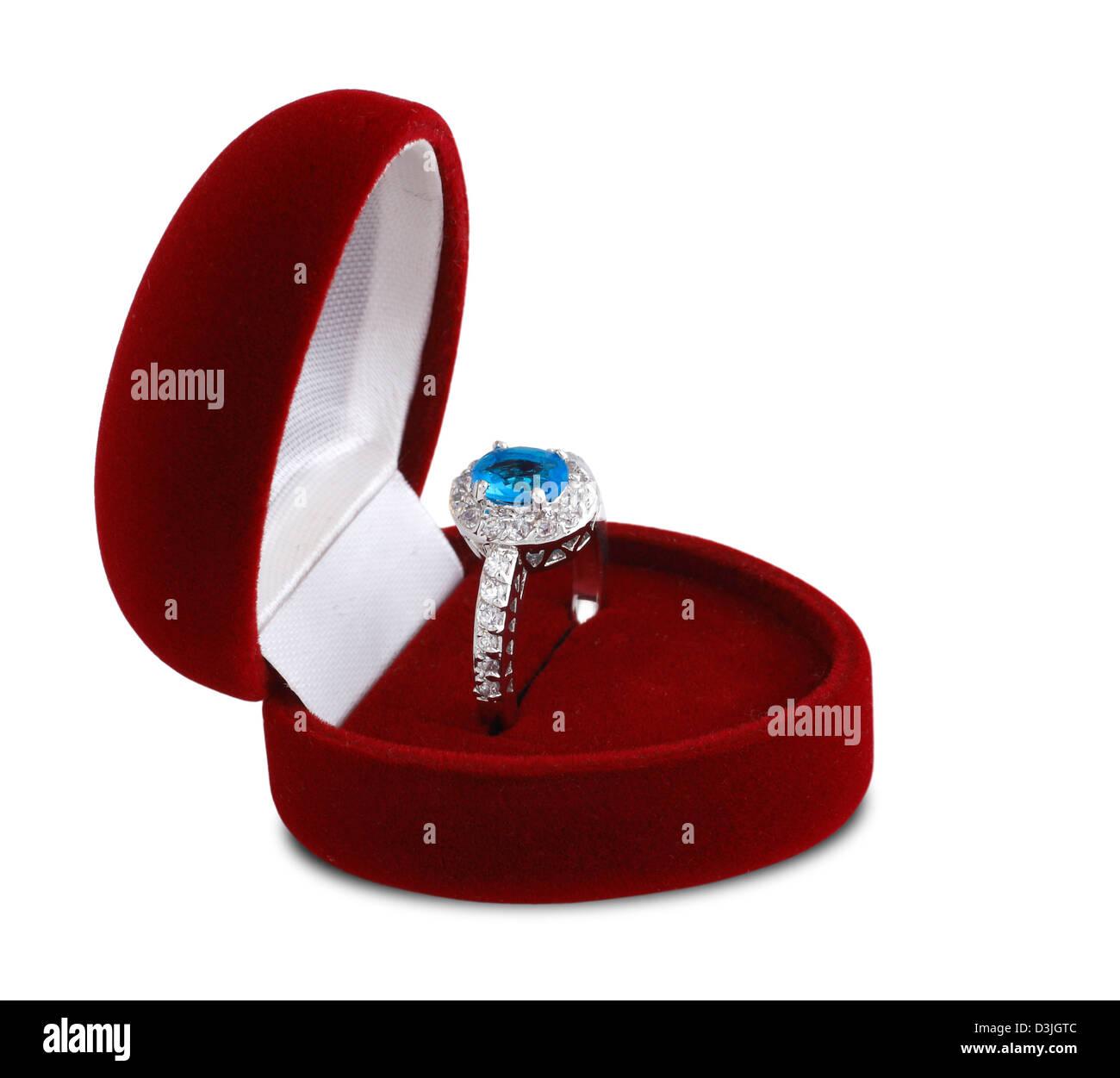 diamond ring in red velvet box isolated on white background - Stock Image