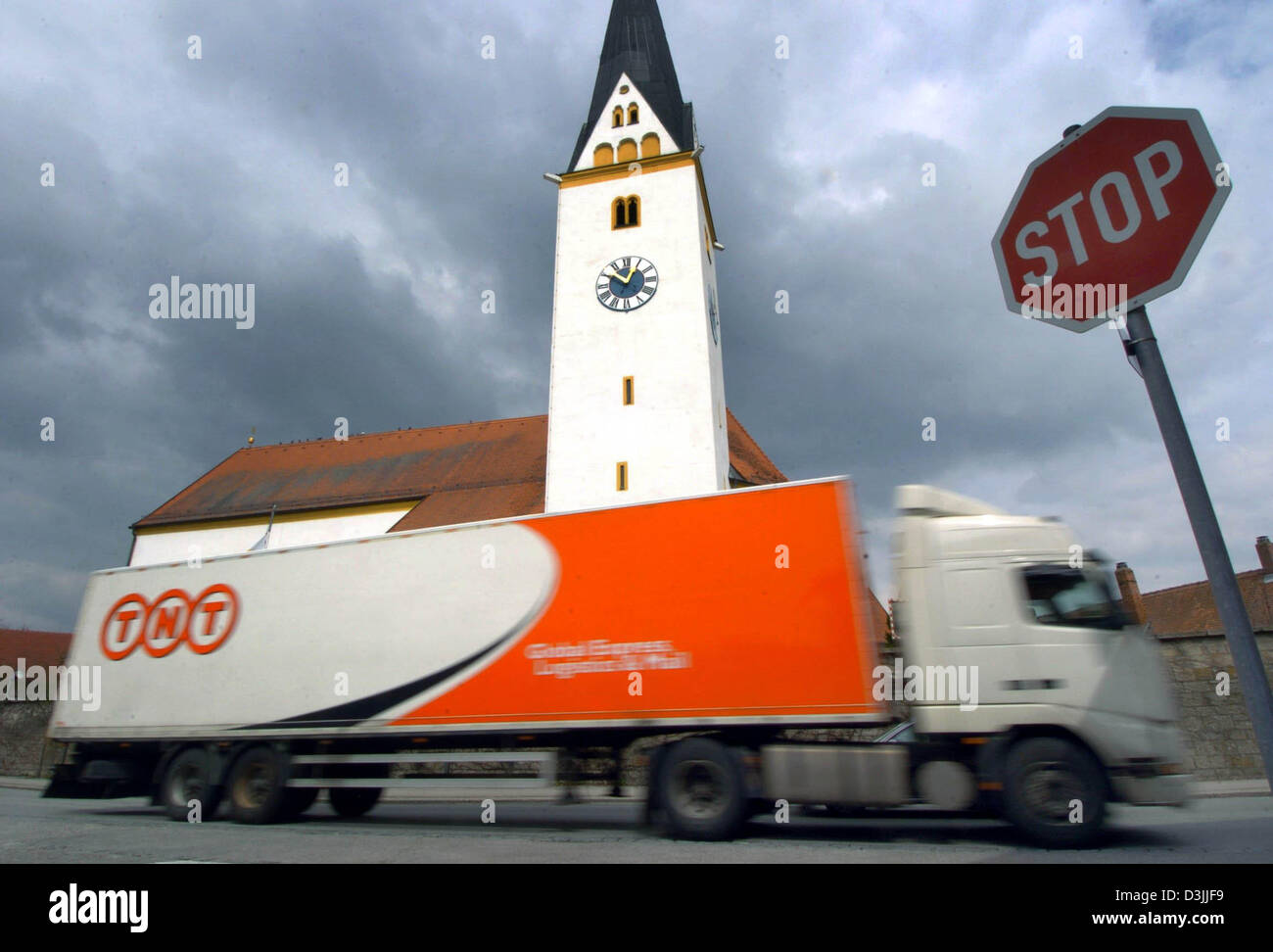 (dpa) - A large lorry drives along the through road through the town of Strasskirchen, Germany 11 April 2005. German Stock Photo