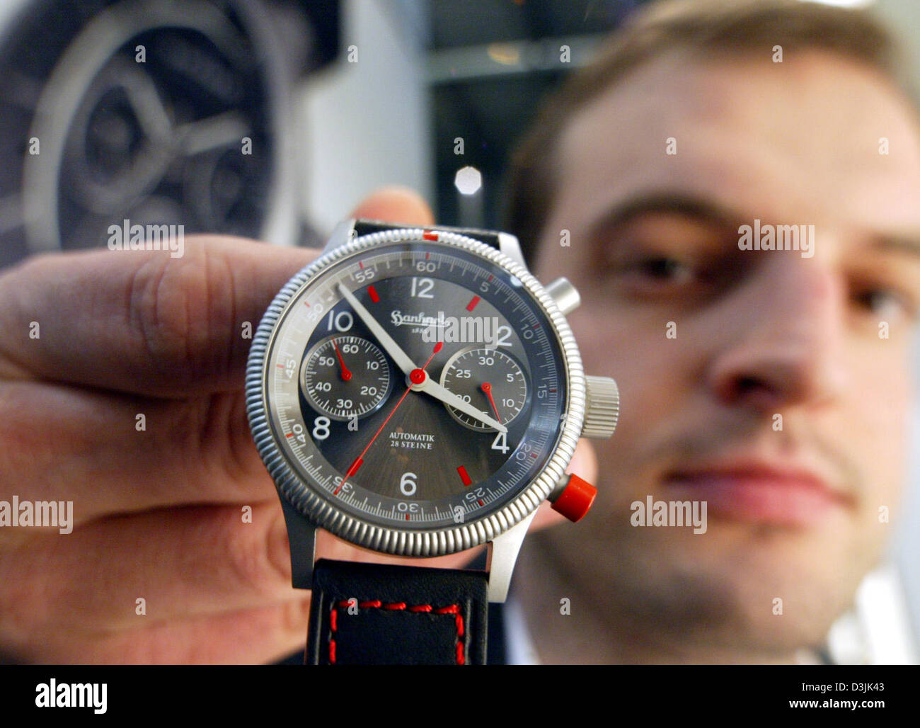 (dpa) - Gernot Safron, sales manager of German watchmaker Guetenbach, holds an automatic chronograph 'Hanhart - Stock Image