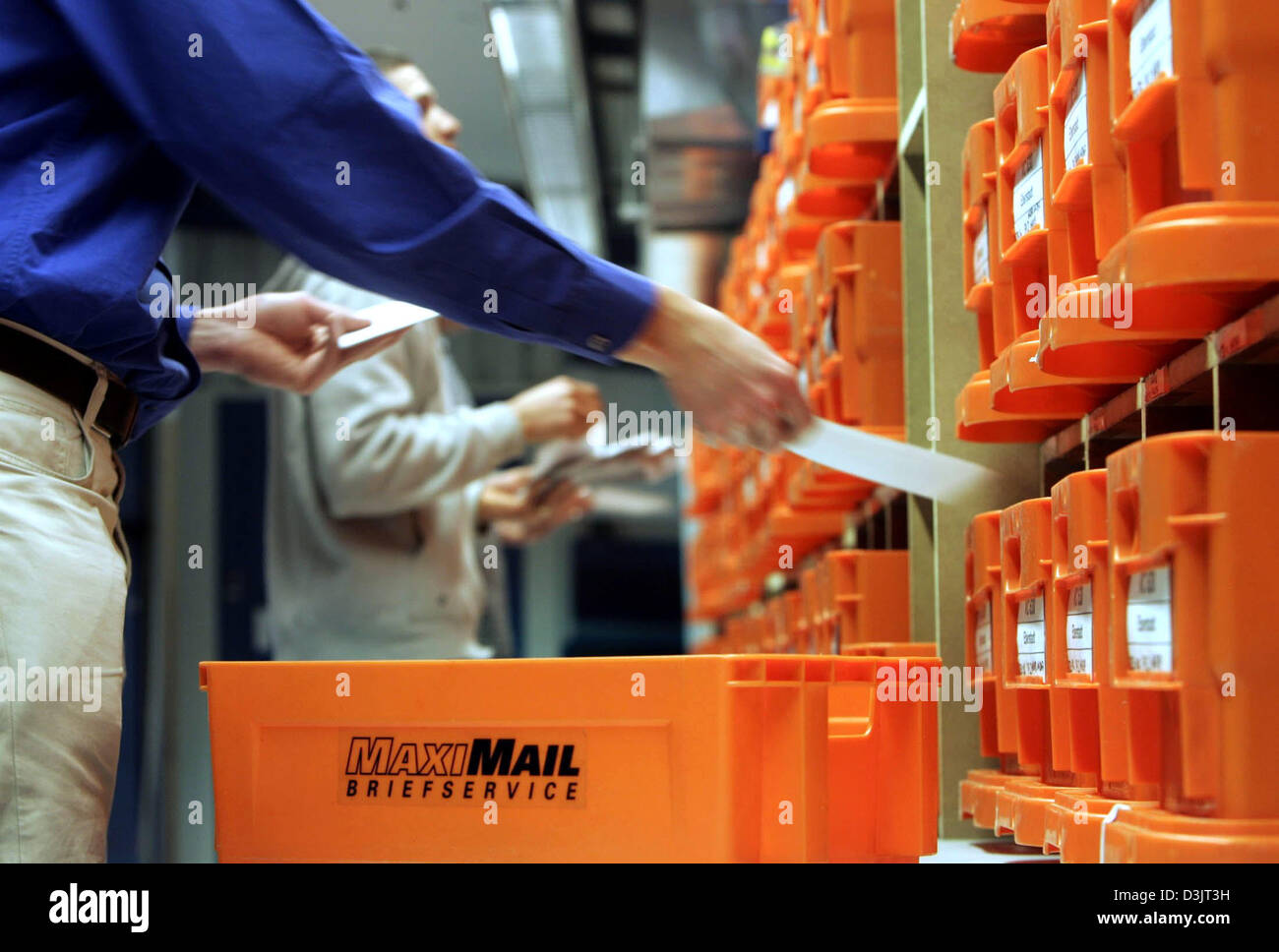 (dpa) - Employees of private German postal service MaxiMail manually sort letters in Darmstadt, Germany, 13 January Stock Photo