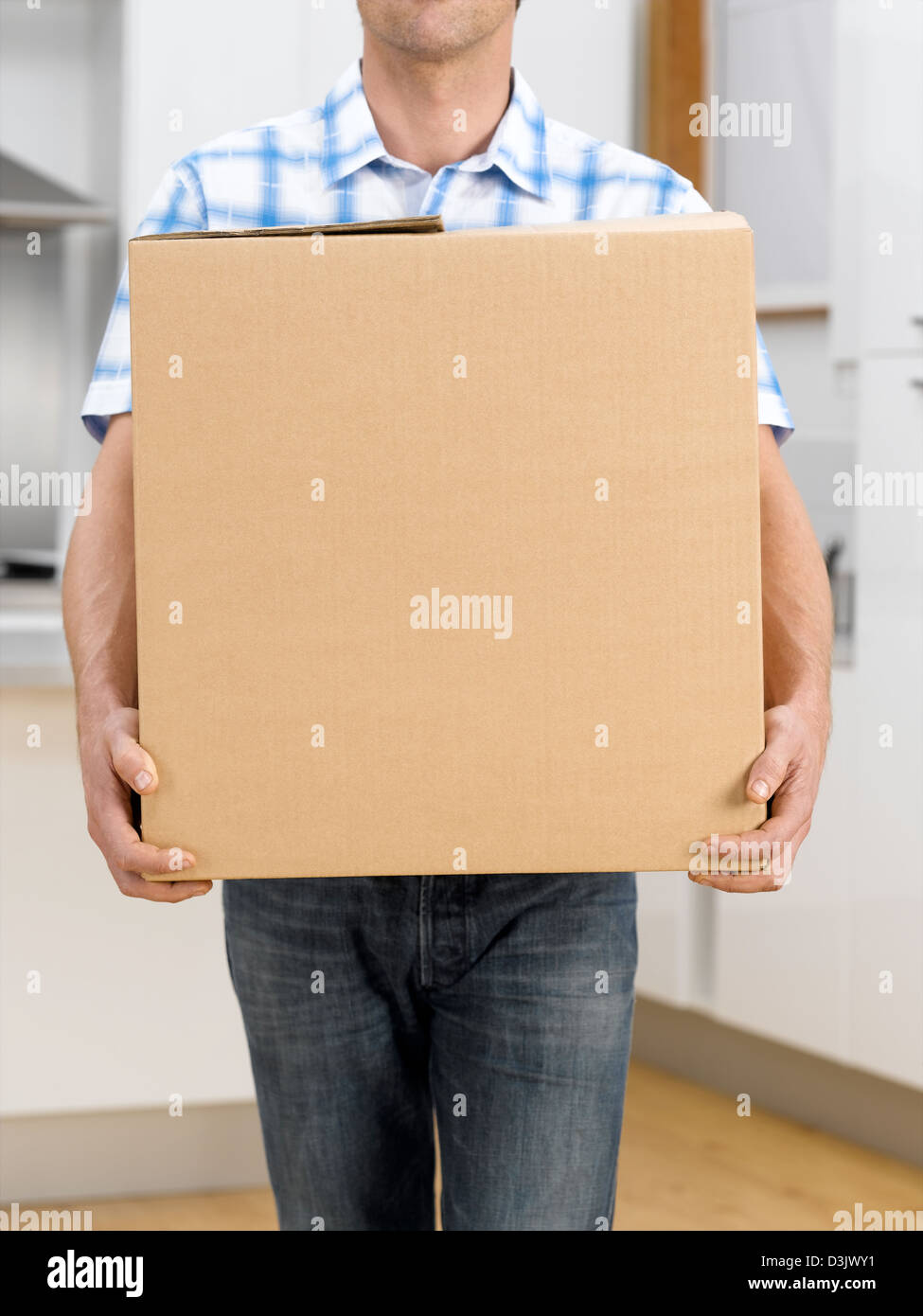 man carrying box - Stock Image