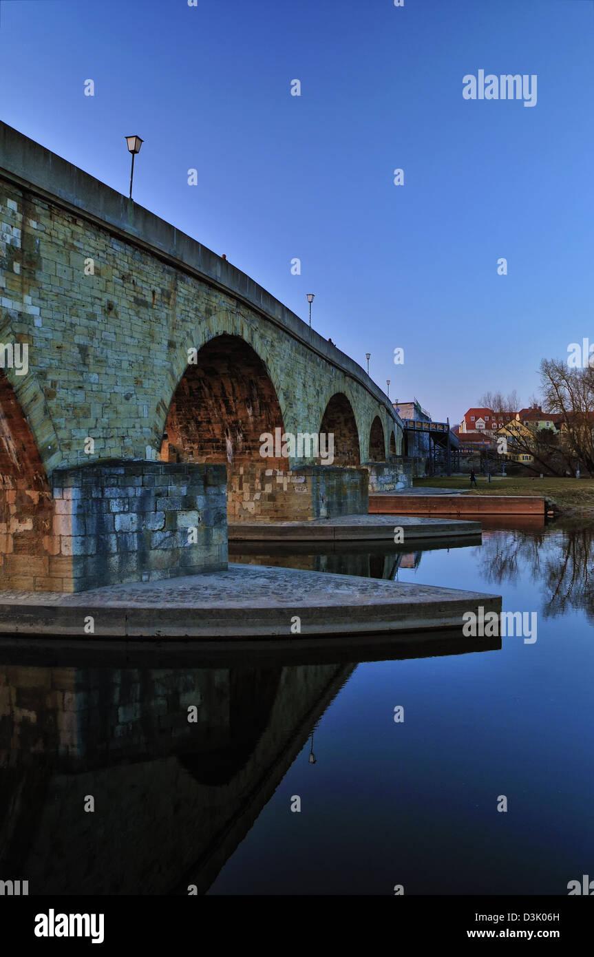 The old Stone Bridge and Brücktor city gate in Regensburg, Bavaria, Germany spanning the Danube River. Stock Photo